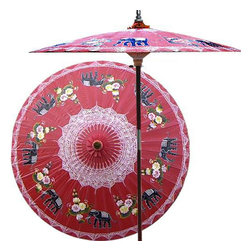 "Oriental-Décor - Asian Elephants (Dragon Red) - This magnificent patio umbrella highlights a circle of Asian elephants, which symbolize strength, power and wisdom. Lovingly hand-made in Asia, where the elephant is the national symbol, this umbrella is the perfect way to enhance any outdoor area.  - 7 foot umbrella pole constructed of rich stained oak hardwood.  - Each umbrella is entirely handcrafted down to the finest detail.  - Oil-treated cotton umbrella shades are all hand-painted by our master artists.  - Dual position shade height allows for full coverage or a better view of the painted shade.  - Waterproof and weatherproof.  - Two-piece pole fastens securely with a polished metal coupling.  - Pole diameter of 1.5"" easily fits into any standard size umbrella base or table.  - Optional umbrella base available - handcrafted from stained oak hardwood."