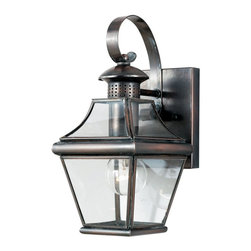 Quoizel - Quoizel Carleton CAR8406AC Outdoor Wall Lantern - CAR8406AC - Shop for Wall Mounted from Hayneedle.com! The Carleton Wall Lantern is a copper lamp with an aged copper finish that will add a refined antique look to your home's exterior. With a beveled-glass shade and colonial style this lamp will remain a classic for years to come. It measures 5.5W x 11.5H inches and requires three 60-watt candelabra base bulbs (not included).About Quoizel LightingQuoizel Lighting has been designing timeless lighting fixtures and home accessories since 1930. It offers a distinctive line of over 1 000 styles including chandeliers lamps and hanging pendants. Quoizel Lighting is the perfect way to add an inviting atmosphere to any area in your home - both indoors and out.