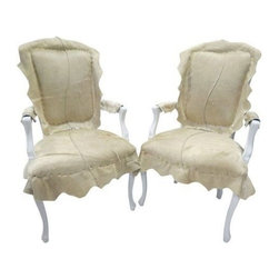 Pair of Cowhide French Chairs - Deconstructed upholstery mades a modern statement on a classically shaped chair. French bergere chair with white wash finish is newly upholstered with cowhide. Seat height 19''