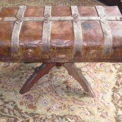 Antique Steamer Trunk Table - A well traveled steamer trunk top re-purposed with sturdy legs. Perhaps it sailed around the world a time or two before it retired to your den or library.