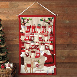 Stocking Advent Calendar - This traditional calendar reminds me of the one that I had as a child, but the Santa and reindeer are a definite step up. I have the perfect spot in my dining room for it.