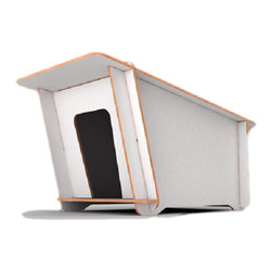 """DogHouse : modern dog house - DogHouse is a modern, stylish dog kennel by Italian design house Fuora. DogHouse is a versatile indoor/outdoor kennel made with a multi-layered birch wood, treated with a thermoplastic overlay to resist all weather conditions. The sides are manually coated with an eco-friendly transparent varnish: """"We wanted the core of the wood to be visible,"""" note Manolo Bossi and Alberto Benedetti, designers and founders of Fuora."""