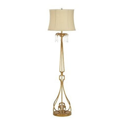 Pacific Coast Lighting El Palacio Floor Lamp - Elegance is key with the Pacific Coast Lighting El Palacio Floor Lamp. This floor lamp is made of metal and features an antique gold finish. A faux raw silk soft bell shade adds charm. Requires one 150-watt medium base bulb (not included). Works via a simple turn on/off socket switch. Hanging clear crystals grace the top of this lamp and delicate curve embellishments are placed at its base. A beautiful piece to place within master and guest bedrooms.About Pacific Coast LightingPacific Coast Lighting was founded in 1979. Since then they have set a standard of excellence for the entire lighting industry. They have built a reputation for innovative design, quality workmanship, and market responsiveness. Pacific Coast Lighting has its own house brand and is the exclusive lighting and accessory manufacturer for several of today's prestigious lifestyle brands. Kathy Ireland Home and National Geographic Home collections are two of these well-respected lines.