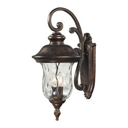 Elk Lighting - Lafayette 2-Light Outdoor Sconce in Regal Bronze - This classic outdoor design incorporates a beautifully detailed backplate and timeless arching arm that holds a flowing, blown water glass body. Constructed of durable cast aluminum and finished in regal bronze.