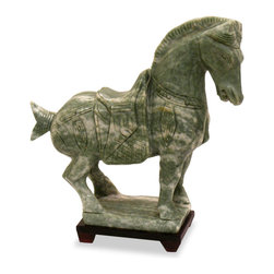 China Furniture and Arts - Hand Carved Jade Tang Horse - The Silk Road was the most important pre-modern Eurasian trade route. When the Silk Road reached its golden age, the Chinese empire welcomed foreign cultures, making the Tang Dynasty capital one of the most cosmopolitan areas in the world. Serving travelers and merchants of all kinds, the horse was by far one of the largest contributors to the enhancement of the Silk Road. Elaborately hand carved from ornamental jade, this Tang figurine of a horse will provide an interesting focus wherever placed. Each piece is unique and slightly varies due to their hand made nature. Please allow us to select one for you. A matching stand is included.