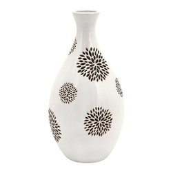 "Imax Worldwide Home - Essentials White with Black Flower Vase - This fabulous and sleek medium white Essentials vase features flower designs hand painted in black with extreme attention to detail. Essentials by Connie designer collection.; Materials: 100% Ceramic; Country of Origin: China; Weight: 5.06 lbs; Dimensions: 16""H x 8""W x 8"""