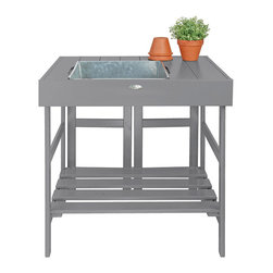 Esschert Design - Painted Potting Table - Expand in the farm folklore collection to make any garden appeal with a country cottage setting! Mix all of your potting soil and tend to all of your gardening needs with this potting table while adding a beautiful decoration to your gardening area.