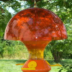 Songbird Essentials - Oriole Magnet 12 inch Baffle - Attracts Orioles and keeps them cool at the same time! All orange color attracts nearby Orioles and 12 inch diameter baffle blocks out sunlight which keeps the feeder underneath cooler. Shade also keeps nectar fresher so it lasts longer. Feeder in picture