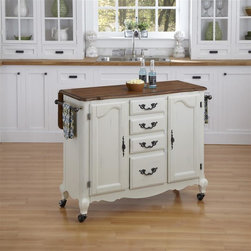 HomeStyles - Oak and Rubbed White Kitchen Cart - The Kitchen Cart is constructed of hardwood solids and engineered wood in a distressed oak and heavily rubbed white finish. The distressed oak features several distressing techniques such as worm holes, fly specking, and small indentations. Features include two large cabinet doors with adjustable shelving, four storage drawers, two towel racks, and four casters (two locking). Design features include shaped carved proud legs, and detailed brass hardware. The drop leaf breakfast bar extends the depth by 29.75 inches. Assembly required. 44.5 in. W x 18.75 in. D x 36 in. H