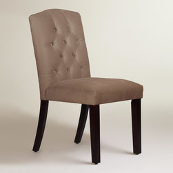 World Market - Velvet Tufted Zoey Dining Chair - Featuring a low profile arched back with hand-tufted buttons, our custom-made dining chair is handcrafted in the U.S.A. of solid pine wood with plush velvet upholstery. Accentuate your dining decor with this classic on-trend silhouette in your choice of colors, mix with your current chairs, or pair it with a vanity or accent table.