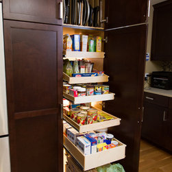 Pantry Pull Out Shelves - ShelfGenie's extensive product gallery will create the ideal pull out pantry to suit your needs and your budget.  This pantry features tray dividers atop custom pull out shelves designed to fit the existing closet pantry.