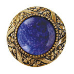 "Inviting Home - Victorian Knob (bright brass with blue sodalite) - Victorian Knob in bright brass with blue sodalite semi-precious stone 1-3/8"" diameter Product Specification: Made in the USA. Fine-art foundry hand-pours and hand finished hardware knobs and pulls using Old World methods. Lifetime guaranteed against flaws in craftsmanship. Exceptional clarity of details and depth of relief. All knobs and pulls are hand cast from solid fine pewter or solid bronze. The term antique refers to special methods of treating metal so there is contrast between relief and recessed areas. Knobs and Pulls are lacquered to protect the finish. Alternate finished are available. Blue Sodalite Semi-Precious stone. Blue Sodalite is a royal blue colored stone that usually has some white or gray-colored streaks. Blue Sodalite looks a bit more crystal-like. It was named by Professor Thomas Thompson who was called in to identify the specimen that was brought from Greenland to Denmark during the time of the Napoleonic wars - he identified it at first as Sodium Aluminum Silicate Chloride. The stone is associated with the Astrological sign Sagittarius and is thought to promote focus clearing mediation and calming of fears. Victorian Jewel pulls and knobs will allow you to have so much fun with the design. The pulls and knobs come in five different kinds of semi-precious stones: Black Onyx Tiger Eye Blue Sodalite Red Carnelian and Green Aventurine. You can even use all of the different colors of the semi-precious stones on one cabinet fa�ade�which would give it an eclectic and playful look."
