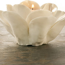 La Vie En Blanc Rose Tealight Candle Holder - Beautifully sculpted in glazed porcelain, one curved silken petal at a time, the La Vie En Blanc Rose Tealight Candle Holder derives a heart of gold from the illumination of a tealight at its center.  This sensitive portrayal of the most romantic of flowers is at home in every conceivable style � its color pure and simple, its crafting naturalistic, and its quality incomparable.