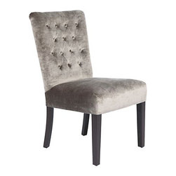 Lola Side Chair - This little beauty would be the perfect accent to any dining room. I love the plush fabric paired with the traditional tufting. So glam!