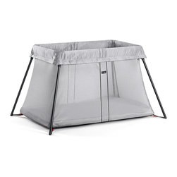 Baby Bjorn - BabyBjörn Travel Crib Light in Silver - Sleeping away from home with small children has never been easier! The Travel Crib Light is easy to carry, set up and fold up. The soft mattress makes the travel crib a comfortable and snug place for your child to sleep on a trip. Suitable for children aged 0-3 years.