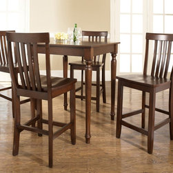 Crosley - Crosley 5 Piece Pub Dining Set with Turned Leg and School House Stools - KD52001 - Shop for Bar and Pub Tables with Stools from Hayneedle.com! The 5-Piece Pub Dining Set with Turned Leg and School House Stools with its decorative wood turning exhibits style defined by master craftsmen. This set includes table and 4 stools. The table and stools are built from hand rubbed hardwoods and the table is accented with a lovely wood veneer. The table's legs are crafted with a decorative wood turned spindle design while the high stools feature a comfortable back. This smaller size set will fit in a smaller apartment a breakfast nook or become a handsome focal point within your family room. You'll appreciate the portability of these chairs so you can offer unexpected company a welcome seat within your home. About Crosley FurnitureIn 1920 Powel Crosley founded the company that pioneered radio broadcasting and mass market manufacturing around the world starting with a simple radio meticulously crafted with obsessive detail and accuracy and a measure of consideration for the wallet. These high ideals have served the company well for over 90 years and they live on in the newest addition to the family. Crosley Furniture sets a new standard for innovation function and meticulous craftsmanship in the manufacture of value-priced furniture. They proudly offer durable furniture products featuring hardwood and veneer construction with rich multi-step finishes in a multitude of styles.