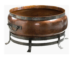 Modern Fire Pits, Contemporary Fire Pits - Great for Fall and Winter - The Jatex Copper Fire Pits have such a commanding presence that it will instantly become the centerpiece in any outdoor setting. It can be paired with vintage furnishings and statuary for a regal appearance, or placed alongside minimalist décor in a patio space or poolside. This rustic fire pit is crafted from premium .8mm copper, which weathers to a gorgeous verdigris patina over time. The deep bowl will accommodate several logs and the bottom grate maximizes air flow to keep the fire burning strong. The surrounding frame is made from heavy gauge iron, which holds the fire bowl securely and adds to the distinctive old-world appeal. Please note that this is meant for outdoor use only and should not be placed on or near a combustible surface.