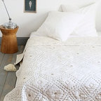 Diamond Stitch Quilt - Dress your bed with enticing textures and layers. I love the quilted top stitch, embroidered sequins and oversize pom-poms in this diamond quilt. Exquisite!