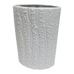 Bahari - Porcelain Melon Vase - Our matte finish, milky-white porcelain Melon Vase has a cylindrical shape and ribbed design that adds an organic sensibility to any floral arrangement or grouping of objects. Using traditional kiln-fired techniques that have been employed since porcelain originated each piece is hand-turned and crafted, thus every piece has its own character.