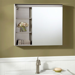 Cascara Stainless Steel Medicine Cabinet with Mirror - With seven possible compartments, the Cascara Medicine Cabinet features two open shelves and two shelves hidden behind its mirror.