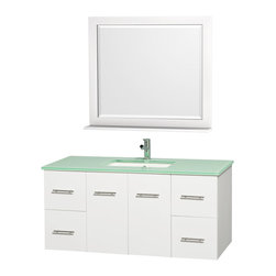 Wyndham - Centra Vanity 48in. in White w/ Green Glass Top & Square sink - Simplicity and elegance combine in the perfect lines of the Centra vanity by the Wyndham Collection. If cutting-edge contemporary design is your style then the Centra vanity is for you - modern, chic and built to last a lifetime. Available with green glass, white carrera marble or pure white man-made stone counters, and featuring soft close door hinges and drawer glides, you'll never hear a noisy door again! The Centra comes with porcelain, marble or granite sinks and matching mirrors. Meticulously finished with brushed chrome hardware, the attention to detail on this beautiful vanity is second to none.