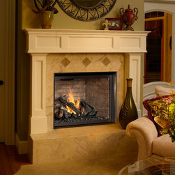 FPX 864 TRV Clean Face Gas Fireplace - Tile installation shown with the Handmade Brick Fireback. Includes Dancing-Fyre Burner, 10-piece log set, 180 CFM Fan, GreenSmart Remote, interior Accent Lights, Comfort Control Feature, and tempered glass. Heating Capacity: 1,400 sq ft BTU Range: 31,000 - 10,000