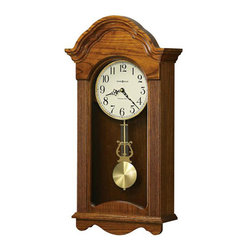 HOWARD MILLER - Jayla Oak Wall Clock with Westminster Chime - Finished in Legacy Oak on select hardwoods and veneers, this wall clock features a scalloped arched bonnet and reeded columns.