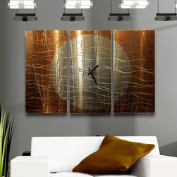 """""""Warm Embrace"""" - Fine Abstract Metal Wall Clock by Jon Allen - The balance of aesthetic beauty and traditional functionality is perfectly blended in this gorgeous contemporary piece. With great attention to detail, you won't know what to compliment first its exquisite artistry or its precise timekeeping. The expert etchings give this triptych an extra dimension of interest, while the warm neutral colors in this metal artwork make it an easy fit in any style home or office."""
