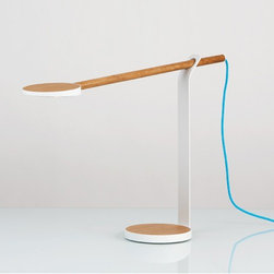 Koncept - Koncept | Gravy LED Desk Lamp - Design by Koncept, 2013.Bring energy efficient LEDs and the warmth of walnut, maple or oak to your office space with the Gravy LED Desk Lamp. Edge lit technology provides a soft, evenly distributed glow of warm light, and the beautiful wood bar, which holds the LED head, is offered in three different natural woods.Choose from the delicately shaded light maple, a medium yet fair white oak, or a rich, deep walnut. An aluminum stand is attached to a matching wood base that is wrapped in aluminum. The thin cord provides a splash of color. Featuring an illuminated LED head that houses 28 LEDs, the wood bar is able to rotate 360° and slides back and forth to provide the user with perfect lighting placement. Controlling the lamp is easy - simply tap the circle in the middle on the underside of the lamp head to power on/off, and tap and hold to dim or brighten the light. This striking combination of real wood and aluminum is perfect for any setting.Shown in white oak with matte white finish.Eligible for LEEDs points: