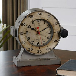 Uttermost Marine Table Clock - 11H in. - The Uttermost Marine Table Clock undoubtedly has the most adventurous underwater stories to tell as it sits on your desk or tabletop. The weathered gray iron body and large aged ivory clock face encased in glass shows both the hour and five-minute increments in a vintage typeface to keep you in-the-know quickly and accurately. No guessing or wasting time counting tick marks in your head. The red secondhand moves across antiqued French wording, showing off its engineering and aesthetically pleasing prowess. Its paint may be a little rough around the well-worn edges, but it's still ticking for a reason.Inspired by deep-water exploration and industrial practicality, the Uttermost Marine Table Clock demands attention while keeping time accurately and reliably with quartz movement, the most widely used timekeeping method in the world.About UttermostThe mission of the Uttermost Company is simple: to make great home accessories at reasonable prices. This has been their objective since founding their family-owned business over 30 years ago. Uttermost manufactures mirrors, art, metal wall art, lamps, accessories, clocks, and lighting fixtures in its Rocky Mount, Virginia, factories. They provide quality furnishings throughout the world from their state-of-the-art distribution center located on the West Coast of the United States.