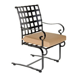 O.W. Lee Classico Wrought Iron Spring Dining Chair - Sit in comfort and style while enjoying the beauty of the outdoors with the O.W. Lee Classico Spring Dining Chair. Designed so you can gently bounce or lean back, this spring dining chair brings comfort, style and tranquility to your backyard. Perfect as part of a set, or great on its own so you never run out of seating, your friends will love coming over to spend warm nights at your house enjoying good food, drinks, and comfortable seating. Made from handcrafted wrought iron, this chair features rich, Old World craftsmanship that adds classic beauty and elegance to your outdoor dining area. The Spring Dining Chair comes with your choice of Sunbrella cushions so you can easily complement your existing decor. Sunbrella cushions come with a five year warranty and are fade, water, mildew, and stain resistant as well as easy to clean with mild soap and water. You'll love having these chairs on your patio to pull up when you have unexpected guests, are hosting Sunday brunch, or just for yourself as you read a book, enjoy a solitary cup of coffee, or getting some work done outdoors instead of being cooped up inside your office. Gorgeous and well-made, the Classico Spring Dining Chair is a lovely addition to any home.Please note: This piece will be delivered with White Glove service which includes location placement. Unpacking and assembling the item will be left to the customer. Due to the custom-made nature of this item, orders usually ship within approximately 5 weeks. Because each item is assembled just for you, orders cannot be cancelled. A 50% restocking fee will apply for returns.This item is custom-made to order, which means production begins immediately upon receipt of each order. Because of this, cancellations must be made via telephone to 1-800-351-5699 within 24 hours of order placement. Emails are currently not acceptable forms of cancellation. Thank you in advance for your consideration in this matter.Materials and construction:Only the highest quality materials are used in the production of O.W. Lee Company's furniture. Carbon steel, galvanized steel, and 6061 alloy aluminum is meticulously chosen for superior strength as well as rust and corrosion resistance. All materials are individually measured and precision cut to ensure a smooth, and accurate fit. Steel and aluminum pieces are bent into perfect shapes, then hand-forged with a hammer and anvil, a process unchanged since blacksmiths in the middle ages.For the optimum strength of each piece, a full-circumference weld is applied wherever metal components intersect. This type of weld works to eliminate the possibility of moisture making its way into tube interiors or in a crevasse. The full-circumference weld guards against rust and corrosion. Finally, all welds are ground and sanded to create a seamless transition from one component to another.Each frame is blasted with tiny steel particles to remove dirt and oil from the manufacturing process, which is then followed by a 5-step wash and chemical treatment, resulting in the best possible surface for the final finish. A hand-applied zinc-rich epoxy primer is used to create a protective undercoat against oxidation. This prohibits rust from spreading and helps protect the final finish. Finally, a durable polyurethane top coating is hand-applied, and oven-cured to ensure a long lasting finish.About SunbrellaSunbrella has been the leader in performance fabrics for over 45 years. Impeccable quality, sophisticated styling and best-in-class warranties prove the new generation of Sunbrella offers more possibilities than ever. Sunbrella fabrics are breathable and water-repellant. If kept dry, they will not support the growth of mildew as natural fibers will. Beautiful and durable, Sunbrella is a name you can trust in your outdoor furniture.About O.W. Lee CompanyAn American family tradition, O.W. Lee Company has been dedicated to the design and production of fine, handcrafted casual furniture for over 60 years. From their manufacturing facility in Ontario, California, the O.W. Lee artisans combine centuries-old techniques with state-of-the-art equipment to produce beautiful casual furniture. What started in 1947 as a wrought-iron gate manufacturer for the luxurious estates of Southern California has evolved, three generations later, into a well-known and reputable manufacturer in the ever-growing casual furniture industry.