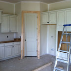 Fountainbrooke Community - These are some examples of the Aristokraft and Schrock cabinetry we supply and install for local builders. Also this shows the most popular cabinet layouts with the staggered heights on the wall cabinets.