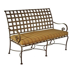 O.W. Lee Classico Wrought Iron Bench - Classic and beautiful, the O.W. Lee Classico Bench is a gorgeous addition to your patio, deck, or garden. Handcrafted from wrought iron, this bench has rich, Old World craftsmanship that adds simplicity and beauty to your backyard. Made so it brings comfort, style, and tranquility to your patio, this gorgeous bench comes with your choice of Sunbrella cushion so you can easily complement your existing patio furniture, or accent the plants and flowers in your garden. Sunbrella cushions come with a five year warranty and are mildew, fade, stain, and water resistant. They're also easy to clean with mild soap and water. Perfect for intimate conversations with friends and family, this bench isn't just for decoration, but also invites you to sit, relax, and enjoy having it in your yard.Please note: This piece will be delivered with White Glove service which includes location placement. Unpacking and assembling the item will be left to the customer. Due to the custom-made nature of this item, orders usually ship within approximately 5 weeks. Because each item is assembled just for you, orders cannot be cancelled. A 50% restocking fee will apply for returns.This item is custom-made to order, which means production begins immediately upon receipt of each order. Because of this, cancellations must be made via telephone to 1-800-351-5699 within 24 hours of order placement. Emails are currently not acceptable forms of cancellation. Thank you in advance for your consideration in this matter.Materials and construction:Only the highest quality materials are used in the production of O.W. Lee Company's furniture. Carbon steel, galvanized steel, and 6061 alloy aluminum is meticulously chosen for superior strength as well as rust and corrosion resistance. All materials are individually measured and precision cut to ensure a smooth, and accurate fit. Steel and aluminum pieces are bent into perfect shapes, then hand-forged with a hammer and anvil, a process unchanged since blacksmiths in the middle ages.For the optimum strength of each piece, a full-circumference weld is applied wherever metal components intersect. This type of weld works to eliminate the possibility of moisture making its way into tube interiors or in a crevasse. The full-circumference weld guards against rust and corrosion. Finally, all welds are ground and sanded to create a seamless transition from one component to another.Each frame is blasted with tiny steel particles to remove dirt and oil from the manufacturing process, which is then followed by a 5-step wash and chemical treatment, resulting in the best possible surface for the final finish. A hand-applied zinc-rich epoxy primer is used to create a protective undercoat against oxidation. This prohibits rust from spreading and helps protect the final finish. Finally, a durable polyurethane top coating is hand-applied, and oven-cured to ensure a long lasting finish.About SunbrellaSunbrella has been the leader in performance fabrics for over 45 years. Impeccable quality, sophisticated styling and best-in-class warranties prove the new generation of Sunbrella offers more possibilities than ever. Sunbrella fabrics are breathable and water-repellant. If kept dry, they will not support the growth of mildew as natural fibers will. Beautiful and durable, Sunbrella is a name you can trust in your outdoor furniture.About O.W. Lee CompanyAn American family tradition, O.W. Lee Company has been dedicated to the design and production of fine, handcrafted casual furniture for over 60 years. From their manufacturing facility in Ontario, California, the O.W. Lee artisans combine centuries-old techniques with state-of-the-art equipment to produce beautiful casual furniture. What started in 1947 as a wrought-iron gate manufacturer for the luxurious estates of Southern California has evolved, three generations later, into a well-known and reputable manufacturer in the ever-growing casual furniture industry.