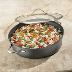 Calphalon - Calphalon Contemporary Nonstick 7 qt. Sauteuse Pan Multicolor - 1876962 - Shop for Sauce and Saute Pans from Hayneedle.com! Wonderfully versatile the Calphalon Contemporary Nonstick 7 qt. Sautese Pan can be used for sauces paella oven casseroles frittata and more. The two cast stainless steel loop handles make it easy to go from stovetop to oven (up to 450 degrees Fahrenheit) too. And that s not all - the hard-anodized heavy-gauge aluminum body facilitates even heating and the triple-layer PFOA-free nonstick surface is exactly what you need. With manufacturer s full lifetime warranty.About CalphalonCalphalon's mission is to be the culinary authority in kitchenwares enhancing the home chef's food experience during planning prep cooking baking and serving. Based in Toledo Ohio Calphalon is a leading manufacturer of professional quality cookware cutlery bakeware and kitchen accessories for the home chef. Calphalon is a Newell-Rubbermaid company.Calphalon's goal is to give you the home chef all the tools you need to realize your highest potential in the kitchen. From your holiday roasting pan to your everyday fry pan count on Calphalon to be your culinary partner - day in and day out for breakfast lunch and dinner for a lifetime.