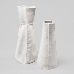 """Souda - Kawa Vase by Souda - The Souda Kawa Vase has such an intricately pebbly texture and realistic seams that you'd think it was made out of leather. But it isn't. It's actually made out of porcelain that's slip cast into a leather mold. The somewhat flexible nature of the mold results in a piece that is truly one-of-a-kind. Based in Brooklyn, New York, Souda is a designer and manufacturer of contemporary furniture, home accessories and lighting. Both the Souda design philosophy and company name (which roughly translates to """"Oh, yeah!"""" in Japanese) is inspired by that wonderful moment of epiphany during the design process. That sense of pleasure and excitement comes through in all of Souda's products."""