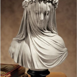 Design Toscano Inc - Design Toscano Inc 14H in. The Veiled Maiden Sculptural Bust Multicolor - NG3152 - Shop for Sculptures Statues and Figurines from Hayneedle.com! About Design ToscanoDesign Toscano is the country's premier source for statues and other historical and antique replicas which are available through the company's catalog and website. Design Toscano's founders Michael and Marilyn Stopka created Design Toscano in 1990. While on a trip to Paris the Stopkas first saw the marvelous carvings of gargoyles and water spouts at the Notre Dame Cathedral. Inspired by the beauty and mystery of these pieces they decided to introduce the world of medieval gargoyles to America in 1993. On a later trip to Albi France the Stopkas had the pleasure of being exposed to the world of Jacquard tapestries that they added quickly to the growing catalog. Since then the company's product line has grown to include Egyptian Medieval and other period pieces that are now among the current favorites of Design Toscano customers along with an extensive collection of garden fountains statuary authentic canvas replicas of oil painting masterpieces and other antique art reproductions. At Design Toscano attention to detail is important. Travel directly to the source for all historical replicas ensures brilliant design.