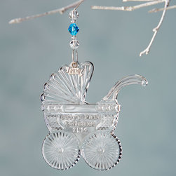 """Waterford - 2014 Baby's First Christmas Ornament - Waterford2014 Baby's First Christmas OrnamentDetailsMade of lead crystal.Two 3""""L jeweled ornament hangers one blue and one pink and a removable 2014 hang tag included.3""""T.Imported.Designer About Waterford Crystal:Established in 1783 Waterford crystal is cherished around the world for its rich tradition of craftsmanship and artistry. Each piece from stemware to decorative items is still mouth blown and handcrafted by master artisans. A customary gift to royalty and heads of state a treasured heirloom for generations."""