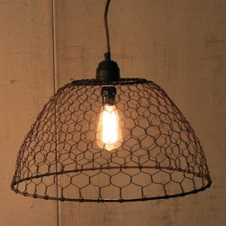 Kalalou NNL2017 Chicken Wire Basket Pendant Lamp - Simply striking, the Kalalou NNL2017 Chicken Wire Basket Pendant Lamp has a rustic, industrial design that blends with any look. This pendant lamp has a country-fresh wire basket that lets your Edison bulb shine through. Perfect as is, but if you want a DIY customized look, weave the chicken wire cage with your favorite fabric or yarn. Requires one 40-watt bulb (not included).About Kalalou IncWhat began as a vacation to Jamaica has grown into a well-loved and global company that finds on-trend, interesting and aesthetically captivating home decor, lighting, and more from artisans around the world. The word Kalalou is the name of a traditional soup never made the same way twice, similar to this company's hand-made products. Always with a nod to the environment, Kalalou remains on the edge of trending designs and themes in home goods and decor.