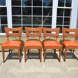Furniture Reupholstery - Set of vintage Heywood-Wakefield dining chairs gets an update with all new seats upholstered in an orange vinyl for an Ocean City, NJ home.