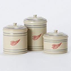 Red Wing Stoneware Canisters - These wing canisters are a modern twist on vintage ceramic containers. Any cabin has to have a safe place to store baking supplies, so no uninvited pests get into your sugar and flour.
