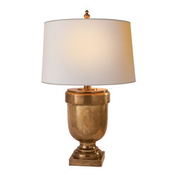 Medium Chunky Urn Table Lamp - Brass is still a hot trend in home design and there's no easier way to play with it than with lighting. Add this elegant lamp to your living room for a sophistacated and warm look. It's the perfect light for curling up with a good book and a cup of tea.