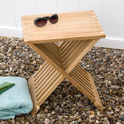 Teak Folding Outdoor Seat - This unique design interlocks to create a sturdy seat for your garden or patio and folds flat for easy storage. Made of teak wood, this folding seat also makes a great side table.