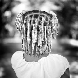 OAC Gallery - Maw Maw's New Braids - Limited Edition Photography by Brandon Thibodeaux - Maw Maw's new braids sparkle in the summer sun outside of her home in Duncan, Mississippi. This is from a series called, When Morning Comes, which is a reflection of life on the Mississippi Delta. Maw Maw's Mother had just spent hours weaving beads into her hair and when it was done, Maw Maw nearly exploded with relief. The image serves as a reminder that all good things come with time if we just have the strength to hold on.