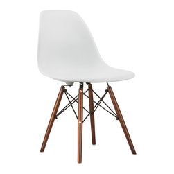 Walnut Slope Chair in White - Our Walnut Slope Chair is inspired by an iconic design of the 1950s and 1960s. The original was born out of technological advancements that allowed a chair to be constructed out of a single mold of fiberglass. With the original mold no longer in production, today's designers have improved this process even further, resulting in a comfortable, stylish, lightweight chair. Replacing fiberglass with more eco-friendly polypropylene, the current iteration is as innovative as it is timeless. It also updates the traditional natural ash wood dowel legs with a rich walnut color. Our Walnut Slope Chair takes this incredible design and makes it accessible and modern, featuring a smooth polypropylene seat that contours to your body. This chair is also one of our most versatile pieces, fitting in at the dinner table, conference table, or anywhere else you're looking to add some seating.