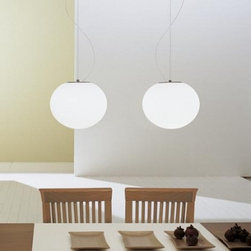 Leucos - Sphera S Pendant - The Sphera S pendant from Leucos is designed by Matteo Thun. A slightly flattened oval highlights this simple glass design that floats off the ceiling and provides diffused illumination from an incandescent light source. A flush ceiling mount is available, in addition to three different size suspensions. Companion table, floor and wall sconces are available. A round, brushed nickel canopy is attached to a standard 4'' junction box. 10' of adjustable cord and cable support the blown-glass diffuser.