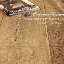 Provence Ancienne Wide Plank Oak Flooring - Our Vintage  Wide-Plank Oak Flooring is available in many color ways.  The photos above are variations of our Gris, Cognac Clair, Cognac and Walnut.   With new techniques that we have been developing, we have new colorways and new surfaces finishes that are extraordinary.   Please understand that colors will always vary depending on the tannins of the wood.  There will always be variations of light and dark and slightly different tones of color from job to job.  However, the techniques we use at Pavé are authentic and hours of hand-labor are involved to make each floor.  This is truly an artisanal product.