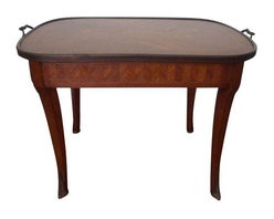 """Pre-owned Antique Inlaid Italian Coffee Table - This beautiful antique inlaid Italian coffee table features the most stunning marquetry, ormolu handles and ormolu mounts at the bottom of the legs. The table has the stamp on the bottom """"Made in Italy"""" and dates to circa early 20th century. The top is in beautiful condition with the exception of some wear of the veneer towards the edges (which you can feel when touching the table but almost impossible to be seen.)"""