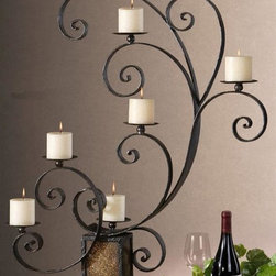 Uttermost - Carolyn Kinder Kara Candelabra - Designer: Carolyn Kinder. Distressed ivory candles included. Made of Metal & Glass. 31 in. W x 9 in. D x 42 in. HHeavily textured aged black metal with rust undertones and crushed golden glass.