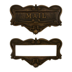 "Adorned Solid Brass ""Mail"" Letter Slot - Featuring an elegant scroll design and ""MAIL"" prominently placed in the center of the cover, this mail slot is perfect for your home's entrance."