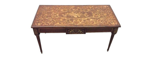 Pre-owned Ormulu & Marquetry Italian Antique Coffee Table - This antique Italian coffee table was purchased at an estate sale in New Jersey. It was said to be from Italy circa 1910. The marquetry and ormulu on this piece are exquisite. The coffee table also has vintage brass banding. Note: One piece is missing.